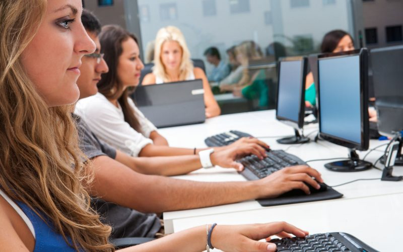 Young people working at computers